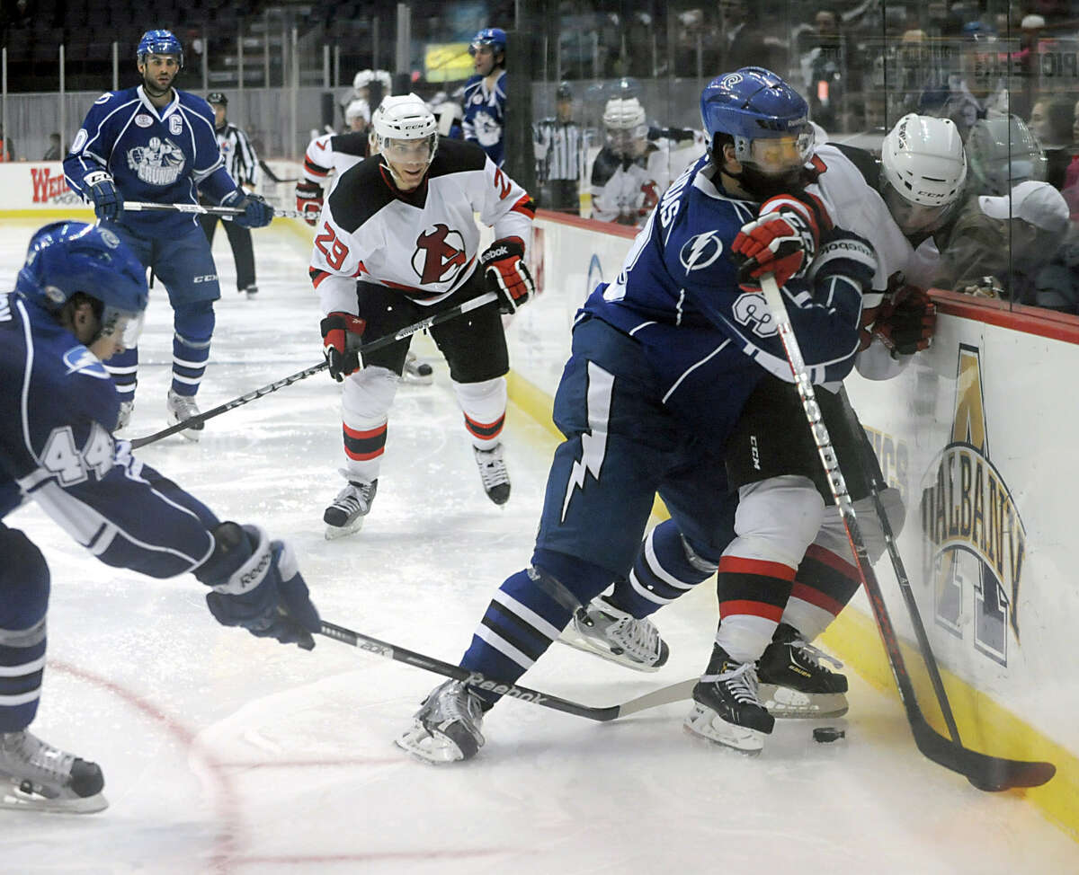 Joe Whitney of the Albany Devils, right, battles for the puck with Radko Gudas of Syracuse during a hockey game at the Times Union Center on Monday Feb. 18, 2013 in Albany, N.Y. (Lori Van Buren / Times Union)