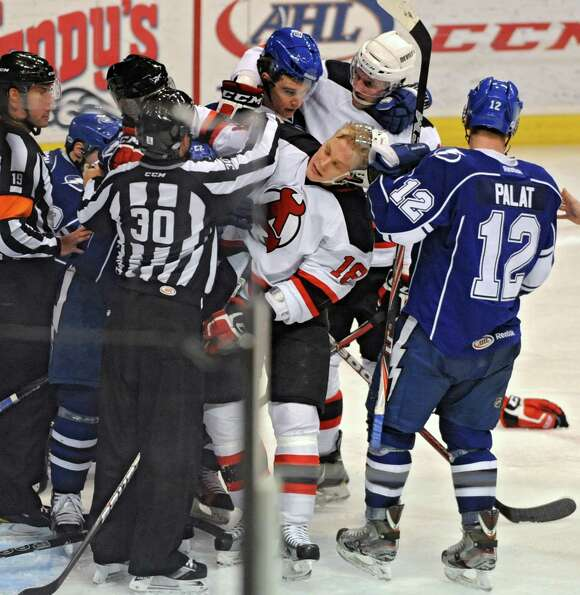 A fight breaks out among several players during an Albany Devils vs Syracuse hockey game at the Time