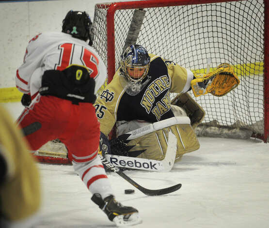 Notre Dame of Fairfield goalie Stone Denbok makes a save on Fairfield Prep's Kenny Kochiss during the first period of their hockey matchup at the Wonderland of Ice in Bridgeport on Monday, February 18, 2013. Photo: Brian A. Pounds / Connecticut Post