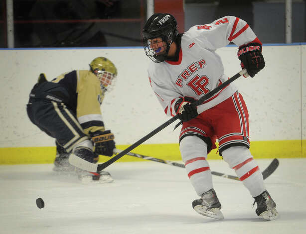 Fairfield Prep's Andrew Hatton plays the puck during the first period of their hockey matchup with Notre Dame of Fairfield at the Wonderland of Ice in Bridgeport on Monday, February 18, 2013. Photo: Brian A. Pounds / Connecticut Post