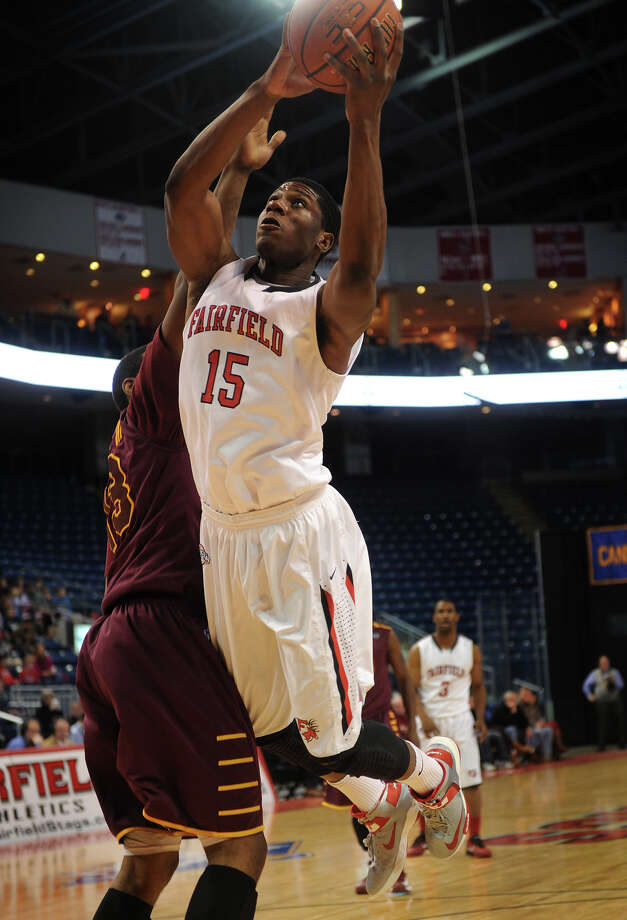 Fairfield's Maurice Barrow drives the ball to the basket against Iona defender David Laury in the first half of their MAAC basketball matchup at the Webster Bank Arena in Bridgeport on Monday, February 18, 2013. Photo: Brian A. Pounds / Connecticut Post