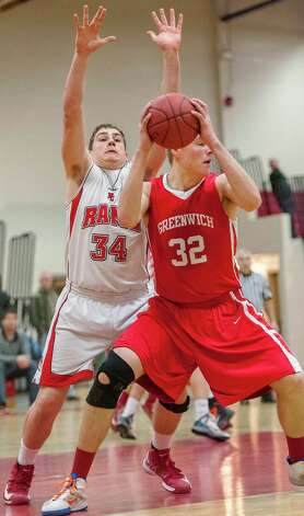 New Canaan high school's Zachary Allen tries to stop Greenwich high school's Alex Wolf from going up for a shot in a boys basketball game played at New Canaan high school, New Canaan, CT on Monday February 18th, 2013. Photo: Mark Conrad / Stamford Advocate Freelance