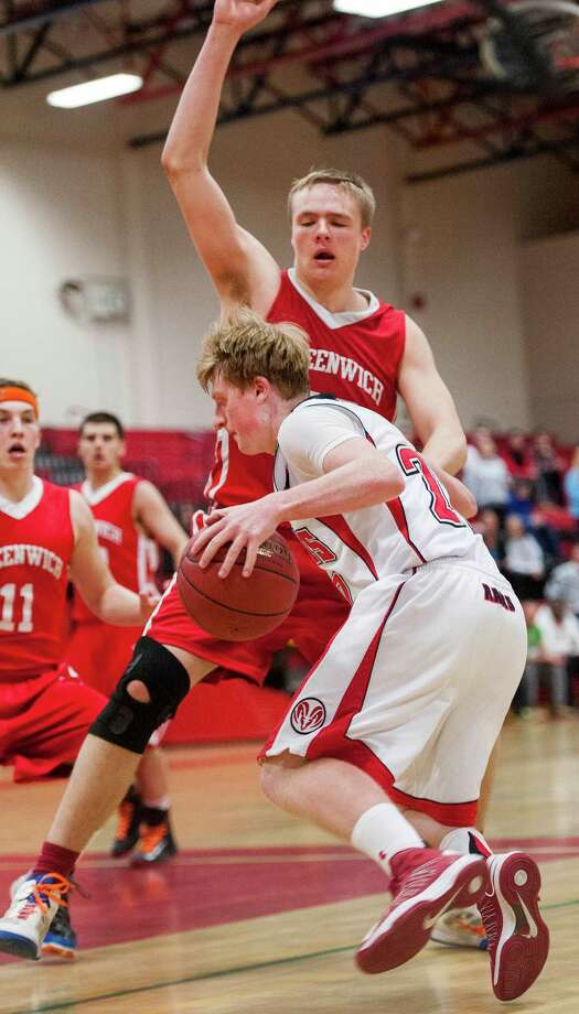 New Canaan high school's Andrew Read drives toward the basket in a boys basketball game against Greenwich high school played at New Canaan high school, New Canaan, CT on Monday February 18th, 2013. Photo: Mark Conrad / Stamford Advocate Freelance