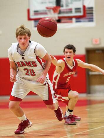 New Canaan high school's Andrew Read goes after a loose ball in a boys basketball game against Greenwich high school played at New Canaan high school, New Canaan, CT on Monday February 18th, 2013. Photo: Mark Conrad / Stamford Advocate Freelance