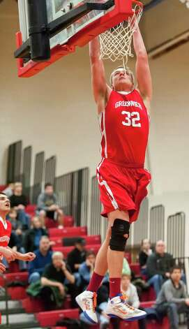 Greenwich high school's Alex Wolf goes up for a dunk in a boys basketball game against New Canaan high school played at New Canaan high school, New Canaan, CT on Monday February 18th, 2013. Photo: Mark Conrad / Stamford Advocate Freelance