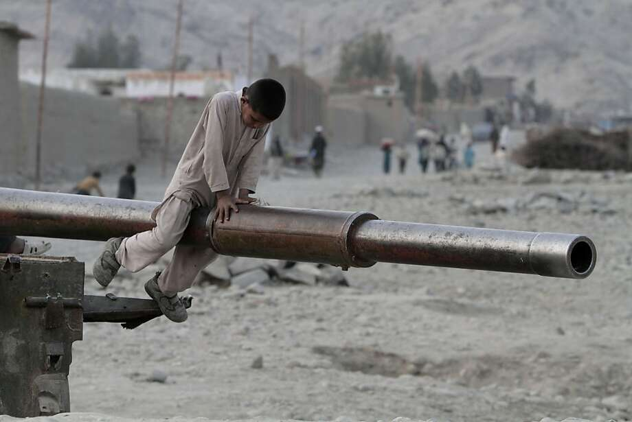 An Afghan child plays on the barrel of a Soviet tank in the Behsood district of Jalalabad, Afghanistan, Monday, Feb 18, 2013. Despite being a mineral-rich country, four decades of war have left Afghanistan as one of the least developed countries in the world and highly dependent on foreign aid. (AP Photo/Rahmat Gul) Photo: Rahmat Gul, Associated Press