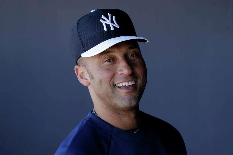 New York Yankees' Derek Jeter smiles in the dugout after a workout at baseball spring training, Monday, Feb. 18, 2013, in Tampa. (AP Photo/Matt Slocum) Photo: Matt Slocum