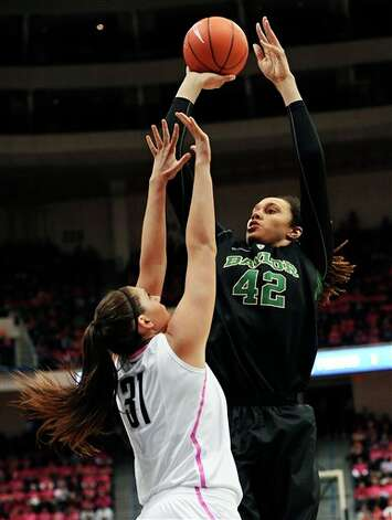 Baylor's Brittney Griner, right, shoots over Connecticut's Stefanie Dolson during the first half of an NCAA college basketball game in Hartford, Conn., Monday, Feb. 18, 2013. (AP Photo/Jessica Hill)