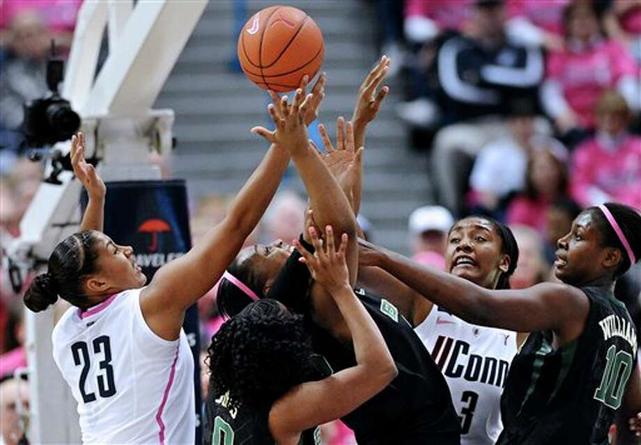 Connecticut's Kaleena Mosqueda-Lewis, left, and Morgan Tuck, second from right, battle for a rebound with Baylor's Odyssey Sims, second from left, Brooklyn Pope, center, and Destiny Williams, right, during the first half of an NCAA college basketball game in Hartford, Conn., Monday, Feb. 18, 2013. (AP Photo/Jessica Hill)