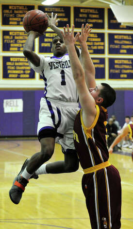 Westhill's Jeremiah Livingston shoots over St. Joseph's Jonathan Dzurenda during their game at Westhill High School in Stamford on Monday, Feb. 18, 2013. St. Joseph won, 63-61. Photo: Jason Rearick / The News-Times