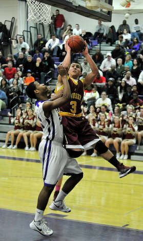 St. Joseph's Jake Pelletier shoots over Westhill's Ariel DelaCruz during their game at Westhill High School in Stamford on Monday, Feb. 18, 2013. St. Joseph won, 63-61. Photo: Jason Rearick / The News-Times