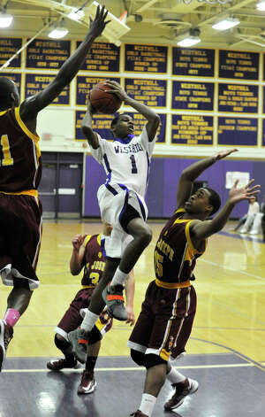 St. Josep's Quincy McKnight, left, and Denzel Moscova attempt to block the shot of Jeremiah Livingston, of Westhill, during their game at Westhill High School in Stamford on Monday, Feb. 18, 2013. St. Joseph won, 63-61. Photo: Jason Rearick / The News-Times