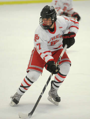 Fairfield Prep's Billy D'Amore plays the puck during their hockey matchup with Notre Dame of Fairfield at the Wonderland of Ice in Bridgeport on Monday, February 18, 2013. Photo: Brian A. Pounds / Connecticut Post