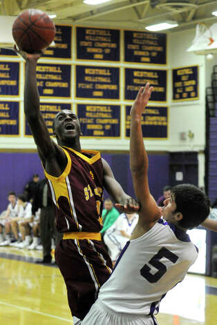 St. Joseph's Quincy McKnight shoots over Westhill's Evan Skoparantzas during their game at Westhill High School in Stamford on Monday, Feb. 18, 2013. St. Joseph won, 63-61. Photo: Jason Rearick / The News-Times