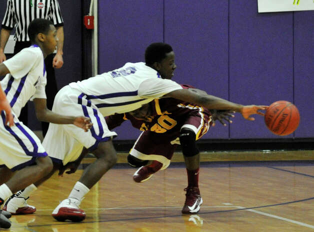 Westhill's Terrell Middleton attempts to steal the ball from Reid Raekwon, of St. Joseph, during their game at Westhill High School in Stamford on Monday, Feb. 18, 2013. St. Joseph won, 63-61. Photo: Jason Rearick / The News-Times