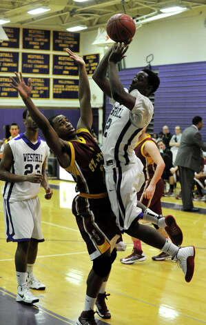 Westhill's Terrell Middleton shoots over St. Joseph's Denzel Moscova during their game at Westhill High School in Stamford on Monday, Feb. 18, 2013. St. Joseph won, 63-61. Photo: Jason Rearick / The News-Times