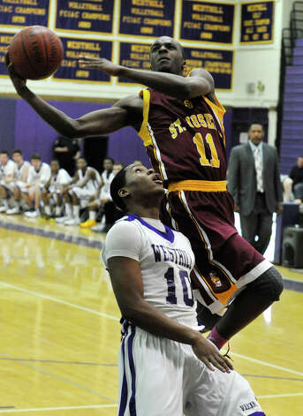 St. Joseph's Quincy McKnight shoots over Westhill's Yveson Cassamajor during their game at Westhill High School in Stamford on Monday, Feb. 18, 2013. St. Joseph won, 63-61. Photo: Jason Rearick / The News-Times
