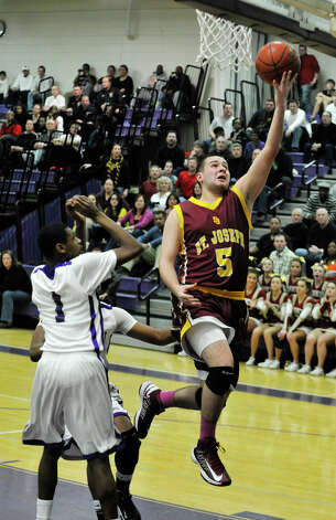 St. Joseph's Jonathan Dzurenda lays the ball in uncontested during their game against Westhill at Westhill High School in Stamford on Monday, Feb. 18, 2013. St. Joseph won, 63-61. Photo: Jason Rearick / The News-Times