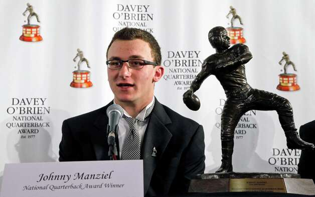 Texas A&M quarterback Johnny Manziel, winner of the Davey O'Brien Award, speaks during a news conference at the Fort Worth Club, Monday, Feb. 18, 2013.  The award is given to the nation's top NCAA college football quarterback.  (AP Photo/The Fort Worth Star-Telegram, Rodger Mallison) Photo: Rodger Mallison, Associated Press / Fort Worth Star-Telegram