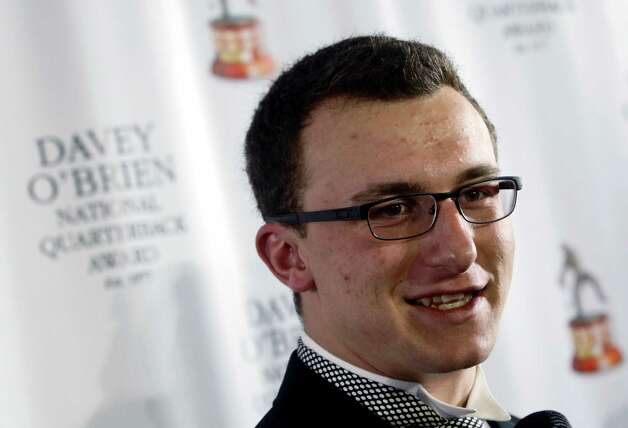 Texas A&M quarterback Johnny Manziel, winner of the Davey O'Brien Award, speaks during a news conference at the Fort Worth Club, Monday, Feb. 18, 2013, in Fort Worth, Texas.  The award is given to the nation's top NCAA college football quarterback.  (AP Photo/The Fort Worth Star-Telegram, Rodger Mallison) Photo: Rodger Mallison, Associated Press / Fort Worth Star-Telegram