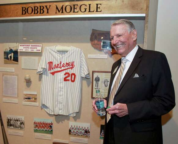 Former high school baseball coach Bobby Moegle stands in front of his display booth at a reception before the induction for the 2013 class of the Texas Sports Hall of Fame, Monday, Feb. 18, 2013, in Waco, Texas. Photo: Jerry Larson, Associated Press / Waco Tribune Herald