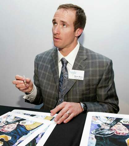 New Orleans Saints NFL football quarterback Drew Brees answers questions while signing a poster at a reception before the induction for the 2013 class of the Texas Sports Hall of Fame, Monday, Feb. 18, 2013, in Waco, Texas. Photo: Rod Aydelotte, Associated Press / Waco Tribune Herald