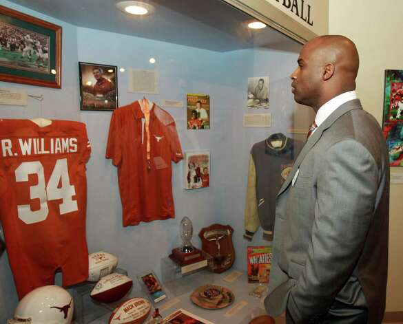Former Texas football player and Heisman trophy winner Ricky Williams looks over his display booth at a reception before the induction for the 2013 class of the Texas Sports Hall of Fame, Monday, Feb. 18, 2013, in Waco, Texas. Photo: Jerry Larson, Associated Press / Waco Tribune Herald