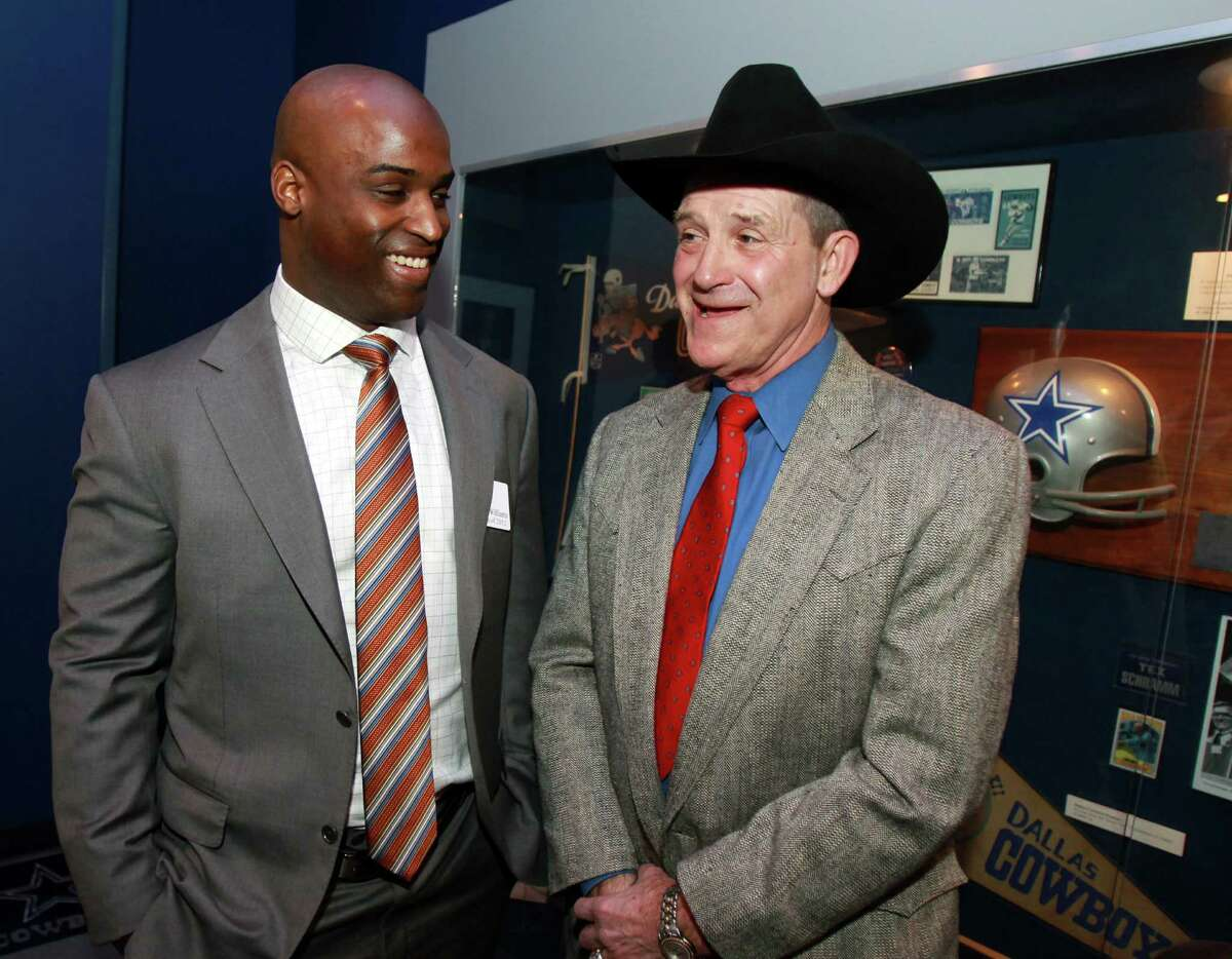 Former Oklahoma State and Dallas Cowboy football player Walt Garrison, right, talks with Texas Heisman winner Ricky Williams, left, at a reception before the induction for the 2013 class of the Texas Sports Hall of Fame, Monday, Feb. 18, 2013, in Waco, Texas.