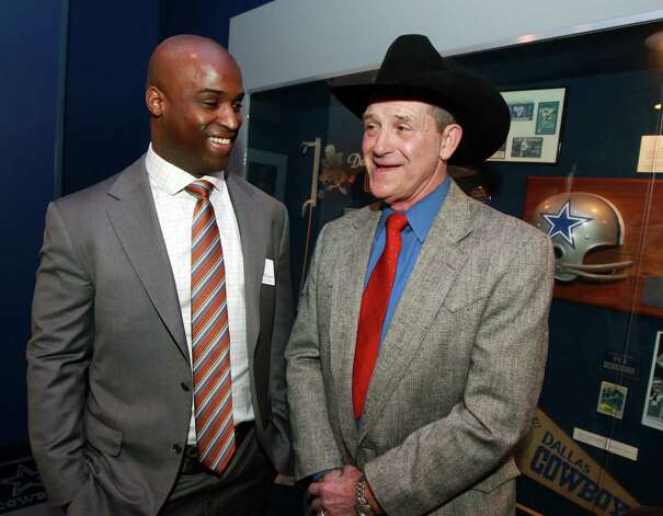 Former Oklahoma State and Dallas Cowboy football player Walt Garrison, right, talks with Texas Heisman winner Ricky Williams, left, at a reception before the induction for the 2013 class of the Texas Sports Hall of Fame, Monday, Feb. 18, 2013, in Waco, Texas. Photo: Jerry Larson, Associated Press / Waco Tribune Herald