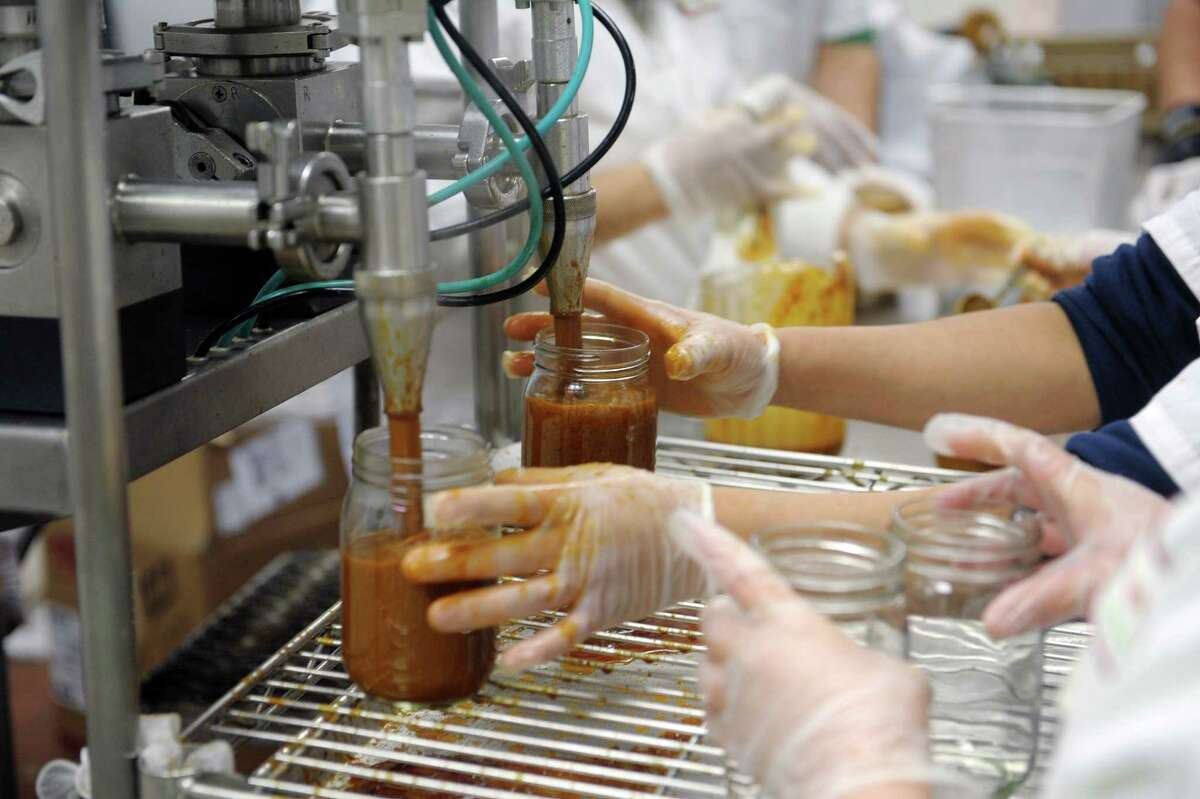 Employees of Farm to Table Co-Packers fill jars with hot dog sauce for Hot Dog Charlie's on Thursday, Feb. 14, 2013 in Kingston, NY. (Paul Buckowski / Times Union)