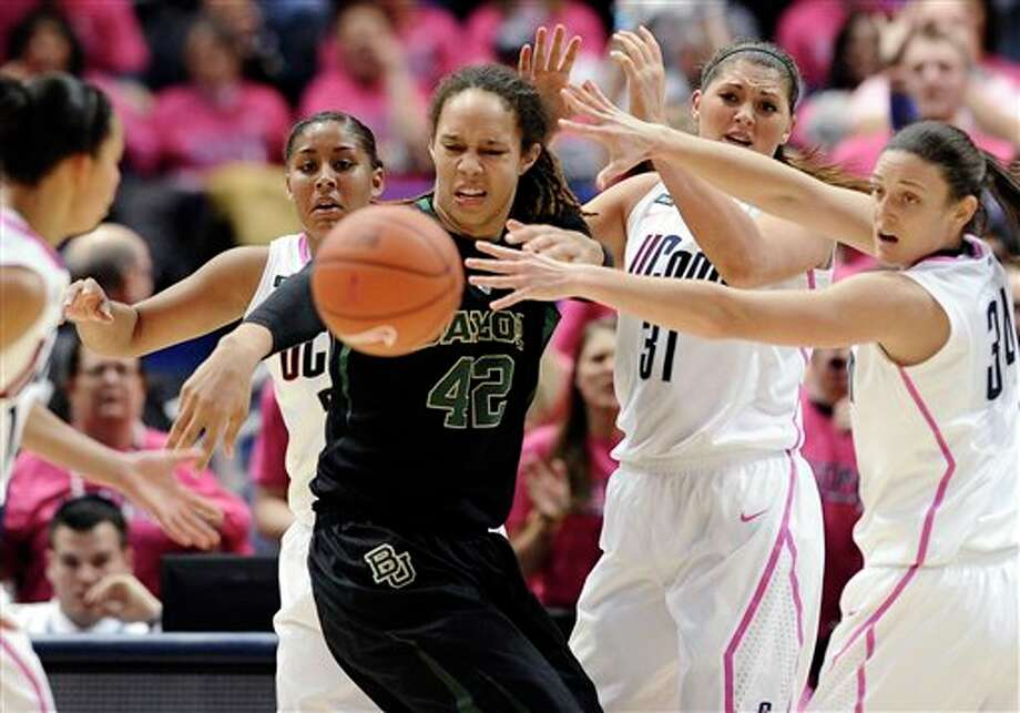 Baylor's Brittney Griner (42) loses possession of the ball from pressure by Connecticut's Kaleena Mosqueda-Lewis, left, Stefanie Dolson, second from right, and Kelly Faris, right, during the second half of an NCAA college basketball game in Hartford, Conn., Monday, Feb. 18, 2013. (AP Photo/Jessica Hill)