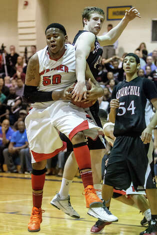 Wagner's Sharone Lewis  (left) fights for a rebound with Churshill's Brian Herring as Abdulla Al-Bader looks on during  the second half of their Class 5A bidistrict game at Clemens High School on Monday, Feb. 18, 2013.  Churchill beat the Thunderbirds 70-50. Photo: Marvin Pfeiffer, San Antonio Express-News / Express-News 2013