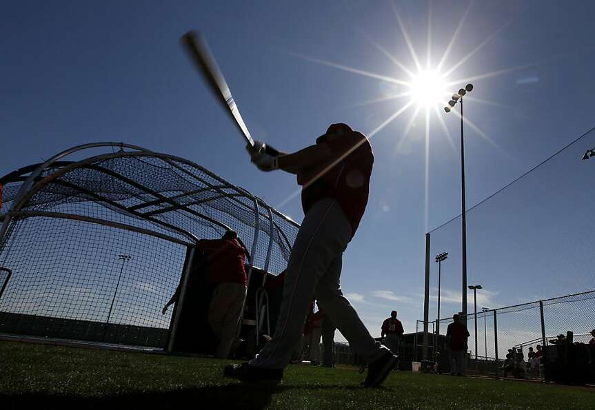 Cincinnati Reds left fielder Ryan Ludwick warms up during spring training baseball in Goodyear, Ariz