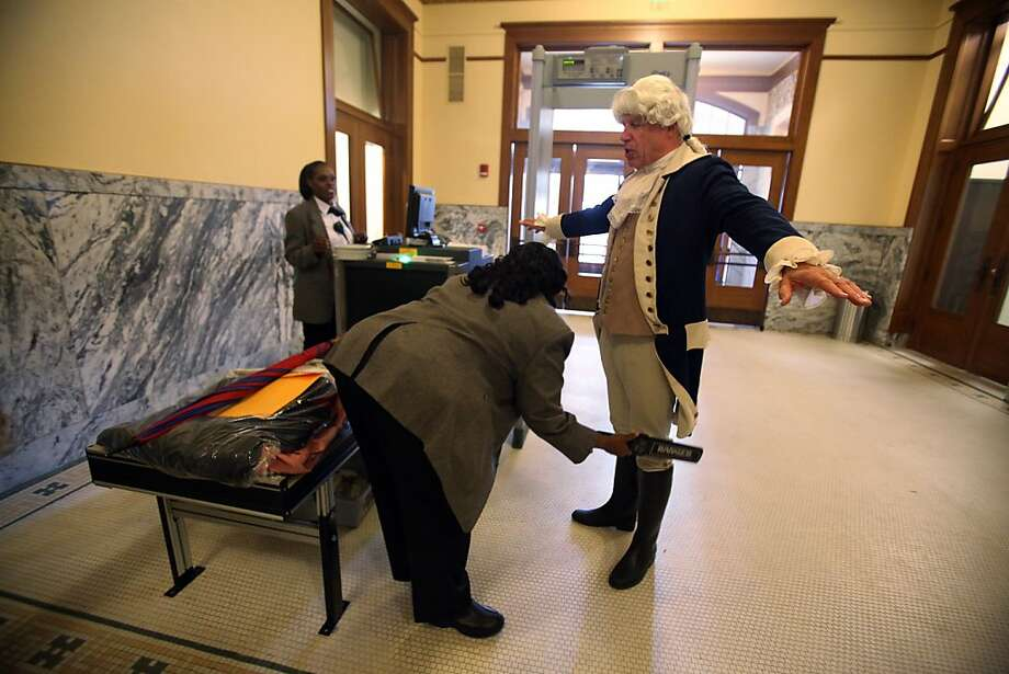 "Ron White, dressed as George Washington, is scanned by security before entering the historic Harris County Courthouse after the ""I Love Texas Courthouses"" campaign to raise awareness and show appreciation for Texas' historic courthouses on Monday, Feb. 18, 2013, in Houston. (AP Photo/Houston Chronicle, Mayra Beltran) Photo: Mayra Beltran, Associated Press"