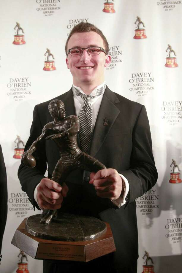 Texas A&M quarterback Johnny Manziel holds the Davey O'Brien National Quarterback Award trophy during the Davey O'Brien Awards press conference at the Fort Worth Club in Fort Worth, Texas, Monday, February 18, 2013. (Rodger Mallison/Fort Worth Star-Telegram/MCT) Photo: Rodger Mallison, MBR / Fort Worth Star-Telegram