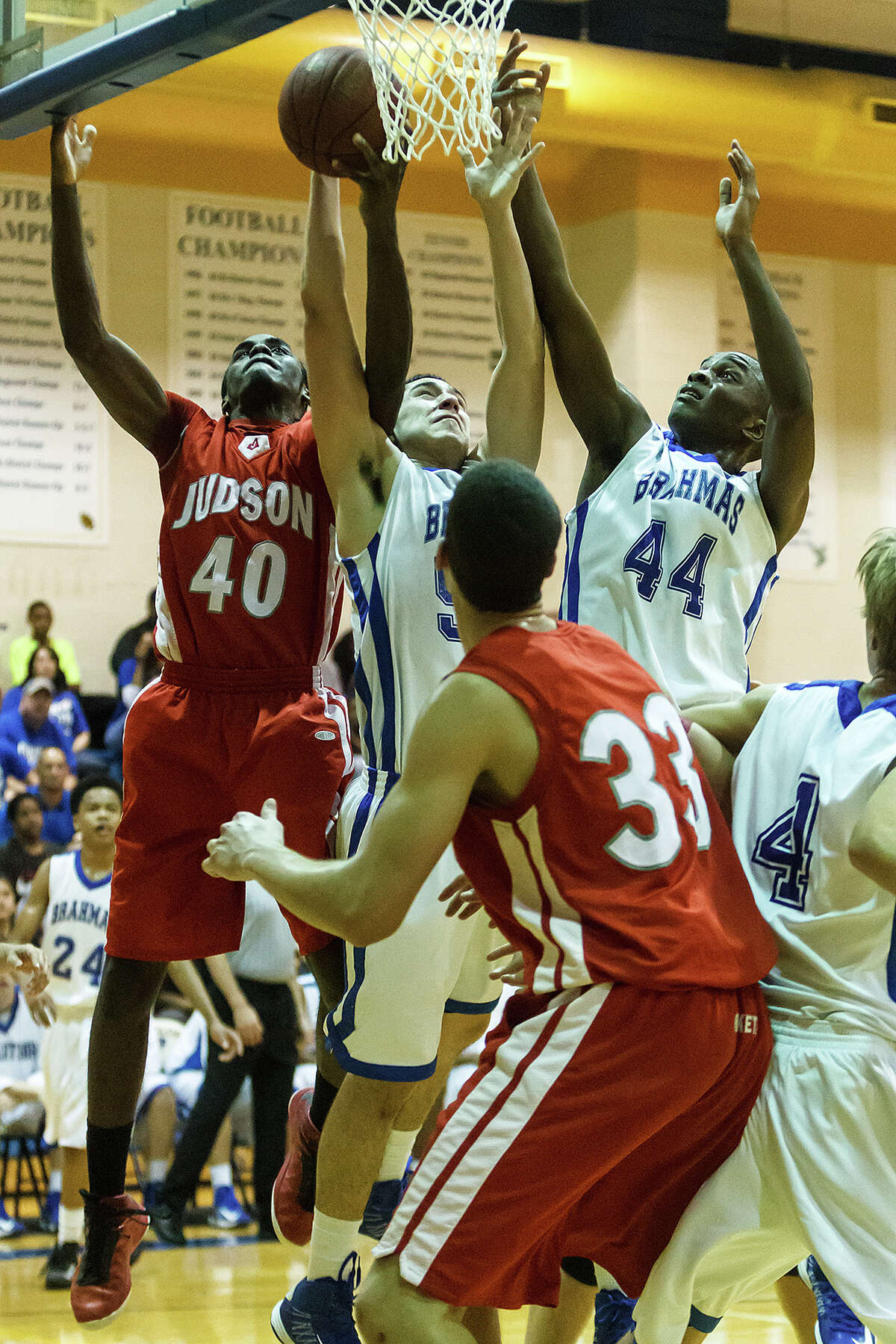 Judson's Derrik Lustger (from left) goes up for a rebound with MacArthur's Nick Garcia and Marco McKee during the first half of their Class 5A bidistrict game at Clemens High School on Monday, Feb. 18, 2013. Judson won the game 49-45.