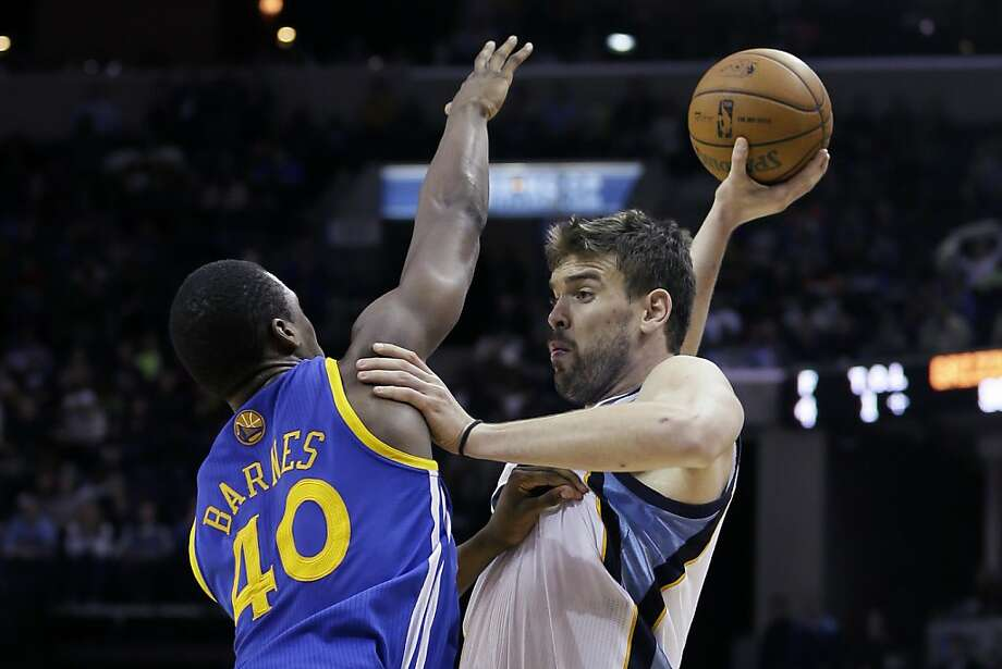 Memphis Grizzlies center Marc Gasol (33), of Spain, tries to shoot over Golden State Warriors forward Harrison Barnes (40) during the second half of an NBA basketball game in Memphis, Tenn., Friday, Feb. 8, 2013. The Grizzlies defeated the Warriors 99-93. (AP Photo/Danny Johnston) Photo: Danny Johnston, Associated Press