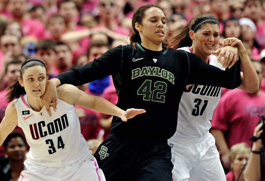 Baylor's Brittney Griner (42) fends off Connecticut's Kelly Faris (14) and Stefanie Dolson (31) during the second half of an NCAA college basketball game in Hartford, Conn., Monday, Feb. 18, 2013. Baylor won 76-70. (AP Photo/Jessica Hill) Photo: Jessica Hill, Associated Press / FR125654 AP