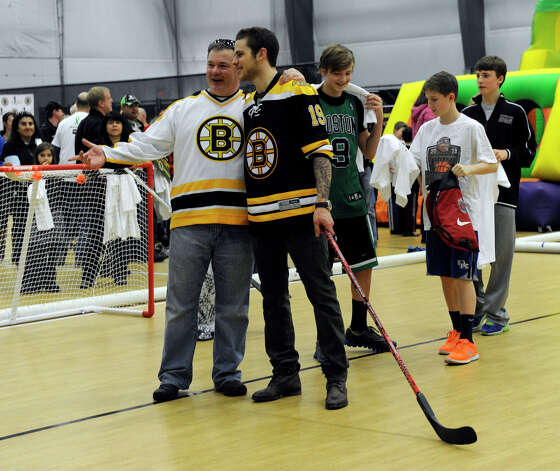 The Boston Bruins hockey team held hockey clinics for Newtown kids at the Newtown Youth Academy, Monday, Feb. 18, 2013. Photo: Carol Kaliff / The News-Times