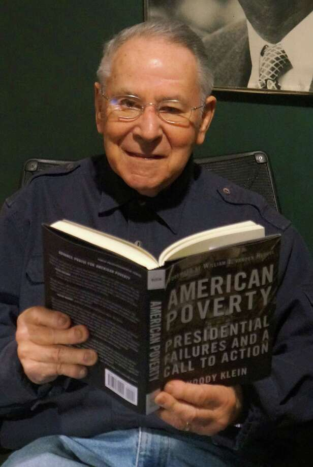 "Woody Klein reads from his new book, ""American Poverty: Presidential Failures and a Call to Action,"" which examines the anti-poverty record of every American president. Photo: Paul Schott / Westport News"
