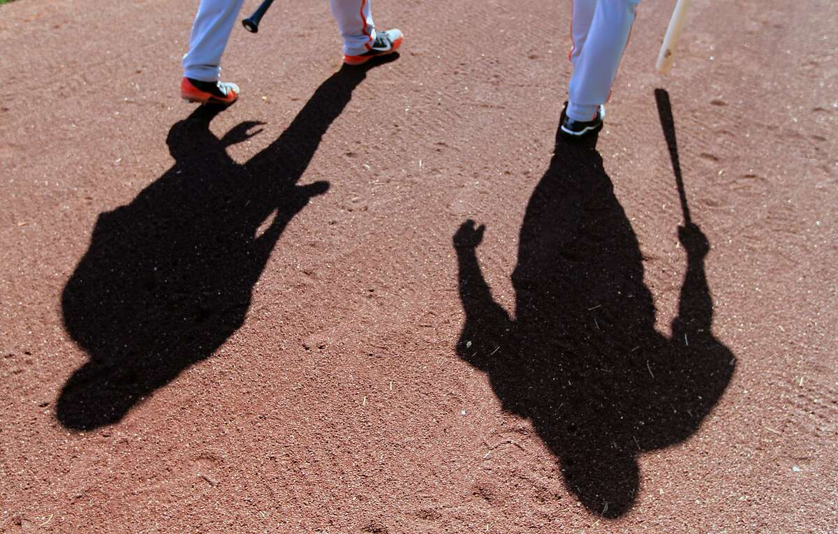 San Francisco Giants' minor league players walk onto the Scottsdale Stadium field for batting practice at spring training Monday, Feb. 18, 2013, in Scottsdale, Ariz.