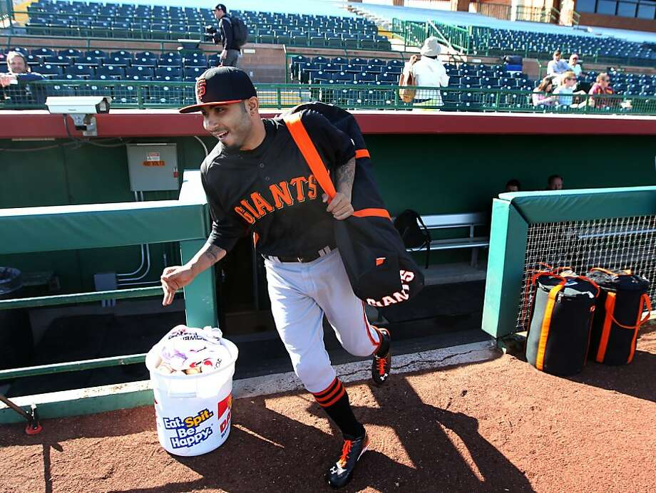 Sergio Romo heads to the field at Scottsdale Stadium on Monday. He said his thoughts on facing hitters again were more about this season than last. Photo: Lance Iversen, The Chronicle