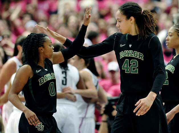Baylor's Odyssey Sims, left, and teammate Brittney Griner react during the second half of an NCAA college basketball game against Connecticut in Hartford, Conn., Monday, Feb. 18, 2013. Baylor won 76-70. Photo: Jessica Hill