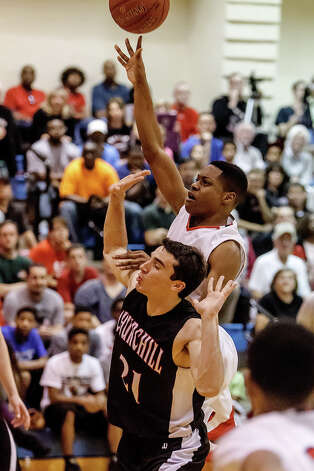 Wagner's Trent Sampson draws a foul as he puts up a shot over Churchill's Drake Bigley during the second half of their Class 5A bidistrict game at Clemens High School on Monday, Feb. 18, 2013.  Churchill beat the Thunderbirds 70-50. Photo: Marvin Pfeiffer, San Antonio Express-News / Express-News 2013