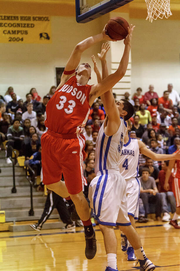 Judson's David Wacker (left) tries to go to the basket around MacArthur's Nick Garcia during the second half of their Class 5A bidistrict game at Clemens High School on Monday, Feb. 18, 2013.  Judson won the game 49-45. Photo: Marvin Pfeiffer, San Antonio Express-News / Express-News 2013