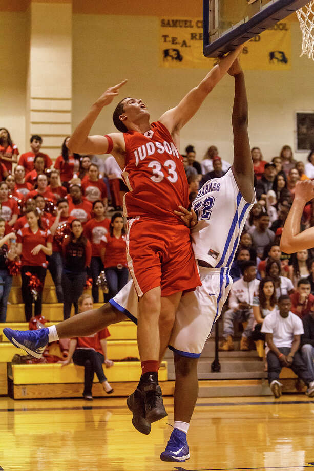 Judson's David Wacker tries to put up a shot from behind the backboard around MacArthur's Jamal Monrore during the second half ofbtheir Class 5A bidistrict game at Clemens High School on Monday, Feb. 18, 2013.  Judson won the game  49-45. Photo: Marvin Pfeiffer, San Antonio Express-News / Express-News 2013