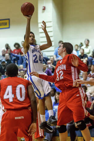 MacArthur's Marcus Herris puts up a jump shot over Judson's Tanner Leissner (right) and Derrik Luster during the second half of their Class 5A bidistrict game at Clemens High School on Monday, Feb. 18, 2013.  Judson won the game 49-45. Photo: Marvin Pfeiffer, San Antonio Express-News / Express-News 2013