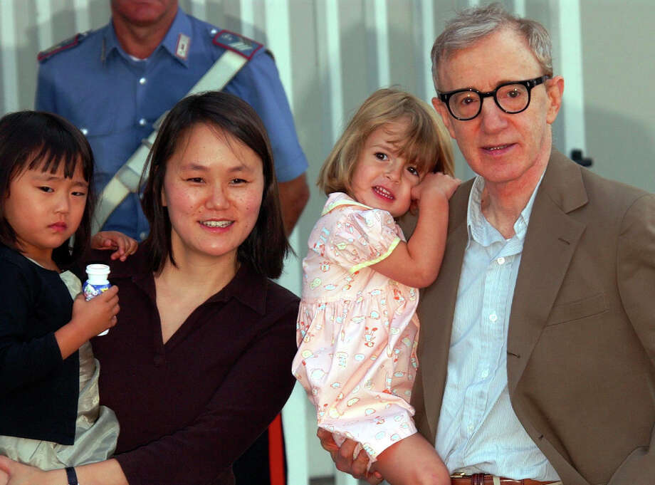 Woody Allen:The screenwriter, director, actor was in his early 60s when he and his wife, Soon-Yi, adopted their daughters, Bechet and Manzie Tio, now ages 13 and 12. Photo: XCJ LUCA BRUNO, ASSOCIATED PRESS / AP2003