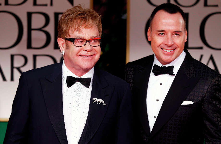 Elton John: The singer/songwriter, 65, and his partner David Furnish had their second child, Elijah Joseph Daniel Furnish-John, through a surrogate mother in January 2013. The couple had their first son, Zachary, also via a surrogate, in 2010. Photo: Matt Sayles, ASSOCIATED PRESS / AP2012