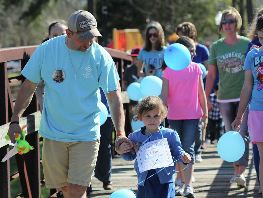 Rodney Herrington walks with his oldest daughter Darby Herrington during the event held Sunday, Feb. 17 at Sandy Creek Park. Photo: Jason Dunn